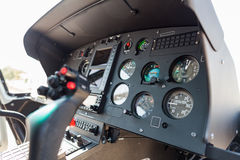 Helicopter cockpit. A helicopter cockpit with the control stick in the foreground and the instruments in the background Royalty Free Stock Photography
