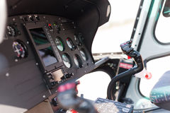 Helicopter cockpit. A helicopter cockpit with the control stick in the foreground and the instruments in the background Royalty Free Stock Photo