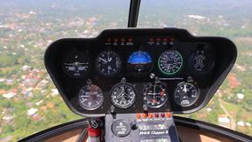 Helicopter cockpit dashboard close up. During flight stock video footage