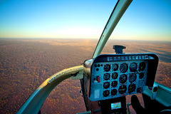 Helicopter Cockpit Flying over Desert Outback Australia royalty free stock image