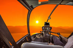Helicopter Cockpit at sunset Stock Photography