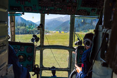 Helicopter Cockpit During Take Off from Landing Camp at Remote Area of Kyrgyzstan. Helicopter Cockpit During Take Off from Landing Camp at Remote Are of Royalty Free Stock Photos