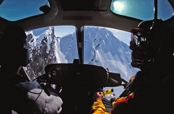 Helicopter cockpit view of the Chugach Mountains of Alaska. During a flight with skiers and snowboarders royalty free stock photography