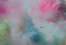 Helicopter through the colored smoke Royalty Free Stock Photography