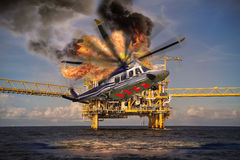 Helicopter crashes into the sea in offshore oil and rig industry, north sea location in offshore industry, rescue of accident Stock Images