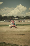 Helicopter Crop Duster. Helicopter used to spread liquid fertilizer on a farm field. Retro instagram look royalty free stock image