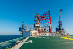Helicopter deck with offshore rig Stock Photos