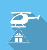 Helicopter delivery cardboard packages Stock Photography