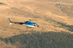 Helicopter Ecureuil AS350 B3 in flight Royalty Free Stock Images
