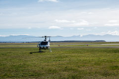 Helicopter on a field Stock Photography