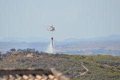 Helicopter fighting bush fire - Aircraft Water Forest Fire Fighters Royalty Free Stock Photography