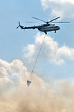 Helicopter at fire Royalty Free Stock Image