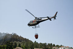 Helicopter fire fighting Stock Photos