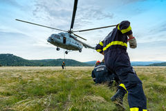 Helicopter and firefighters 2. Firefighters walking Royalty Free Stock Photos
