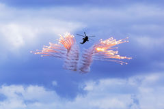 Helicopter firing off flares Stock Photography