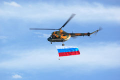 Helicopter with flag royalty free stock photography