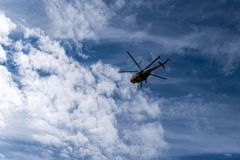 Helicopter flies against sky background Stock Photography
