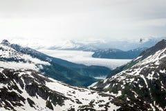 Helicopter flies over Alaska landscape Stock Image