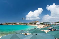 Helicopter flies over the beach, Maho bay, Caribbean Stock Photos