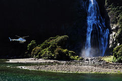 Helicopter flies over Fiordland Royalty Free Stock Image