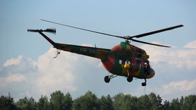 Helicopter flies over the forest, the rescue operation, prospecting stock footage
