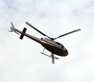 HELICOPTER flies in the sky and carries tourists. Light civil helicopter flies in the sky and carries tourists for sightseeing Royalty Free Stock Photo