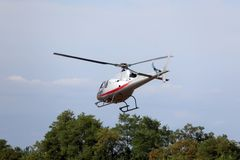 Helicopter flies in the sky and carries tourists for sightseeing Royalty Free Stock Image