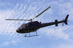Helicopter in flight as seen from below Stock Image