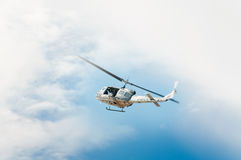 Helicopter in flight, blue sky royalty free stock images