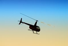 Helicopter in flight at dusk Royalty Free Stock Photography