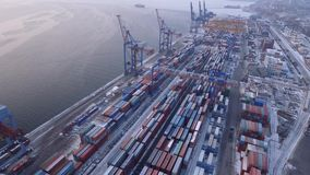 Russia Far East Vladivostok commercial port terminal. Transport logistics center. Winter cold day. Snow on containers. Helicopter flight over high altitude stock footage