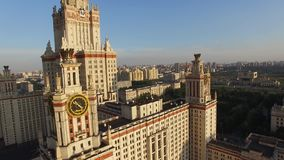 MSU Moscow State University. Close approach to clock. Moscow city center and Luzhniki stadium at background stock footage