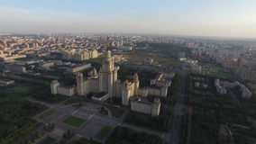 SU Moscow State University. Close approach to star. Moscow city center and Luzhniki stadium at background. stock video footage