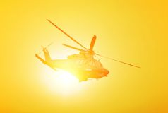 Helicopter in flight Stock Images