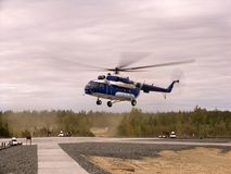 Helicopter fly over airport Royalty Free Stock Image