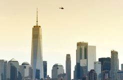 Helicopter fly over the skyscrapers of financial district in low royalty free stock photography
