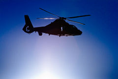 Helicopter fly over the sun Royalty Free Stock Images