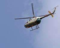Helicopter flying. Green helicopter flying on a nice summer day Royalty Free Stock Photography