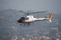 Helicopter flying above town. Helicopter flying up high above town or city Royalty Free Stock Image