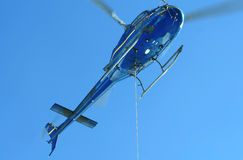 Helicopter flying against the blue sky. Helicopter flying against blue sky Royalty Free Stock Photography