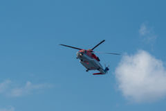 Helicopter flying against the sky. Helicopter flying against the blue sky royalty free stock photos