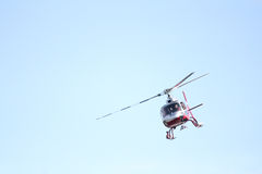 Helicopter. Flying around mountains coming in for a landing royalty free stock photo
