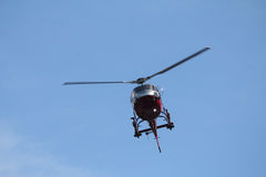 Helicopter. Flying around mountains coming in for a landing Stock Photos