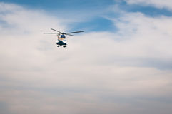 Helicopter flying away Royalty Free Stock Images