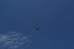 Helicopter flying in the blue sky Stock Photography