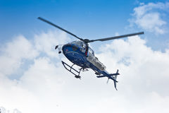 Helicopter flying on clouds Stock Photo
