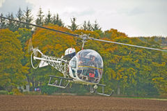 Helicopter flying low. Royalty Free Stock Photos