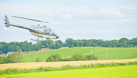 Helicopter flying low at  Nairn Show. Royalty Free Stock Photo