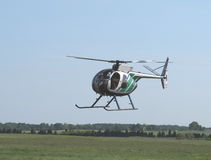 Helicopter flying low over the ground. Stock Images