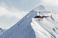 Helicopter flying in the mountains on the Kamchatka Peninsula. Far East Russia Royalty Free Stock Photos